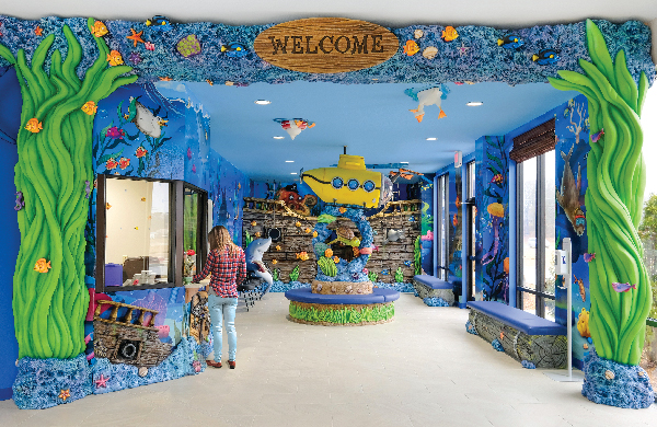 underwater ocean themed reception, waiting room, and kids play area